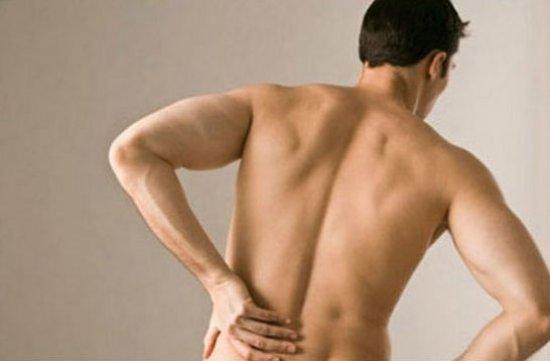 Боль в спине слева